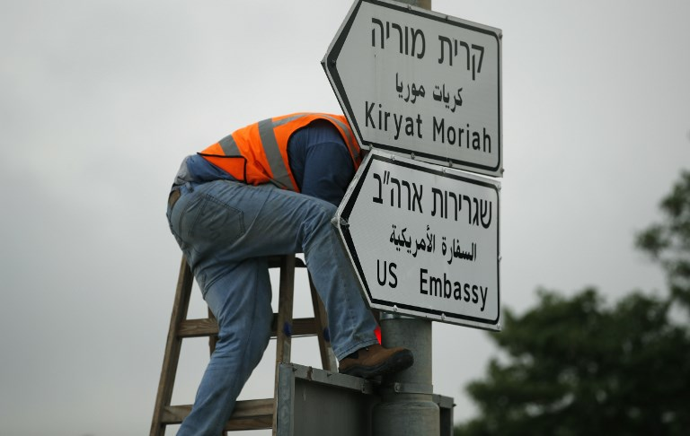 JERUSALEM ADDRESS. A new road sign indicating the way to the new US embassy in Jerusalem is set up on May 7, 2018. The embassy move from Tel Aviv to Jerusalem is expected to occur on May 14. File photo by Thomas Coex/ AFP