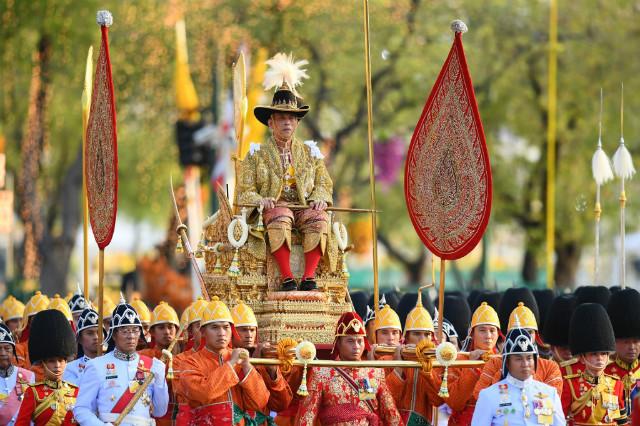 GRAND. Thailand's King Maha Vajiralongkorn is carried in a golden palanquin during the coronation procession, as Princess Bajrakitiyabha Mahidol (bottom L) and Queen Suthida (bottom R) walk alongside, in Bangkok on May 5, 2019.u00c2u00a0Photo by Manan Vatsyayana/AFP