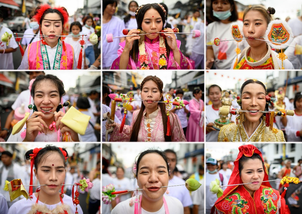 PIERCED. This combination containing 9 photos shows devotees of a Chinese shrine with skewers pierced through their cheeks taking part in a procession during the annual Vegetarian Festival in Phuket on October 5, 2019. Photo by Mladen Antonov/AFP