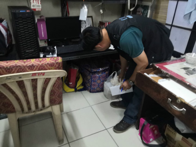 INSPECTION. A Commission on Human Rights staffer inspects the office of rights group Karapatan in Quezon City on November 6, 2019. Photo from Karapatan