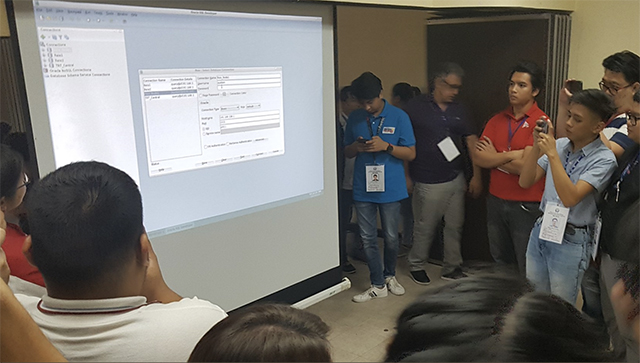 SERVER GLITCH. Representatives of media, watchdog groups and political parties observe as Comelec and Smartmatic debug the Transparency server.