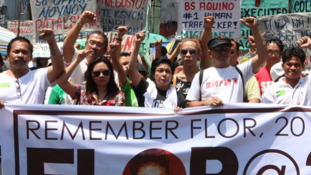 FOR FLOR. Militant groups with actress Nora Aunor (center) call for the resignation of President Aquino for his alleged failure to curb labor migration and protect OFWs. Photo by Joel Leporada/Rappler