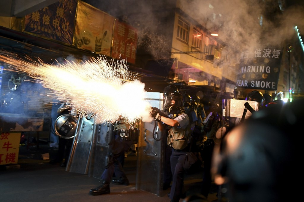 PROTEST DISPERSAL. Police fire tear gas shells to disperse Pro-Democracy protestors in the Sham Shui Po Area of Hong Kong on August 14, 2019.Photo by Manan Vatasyayana/AFP