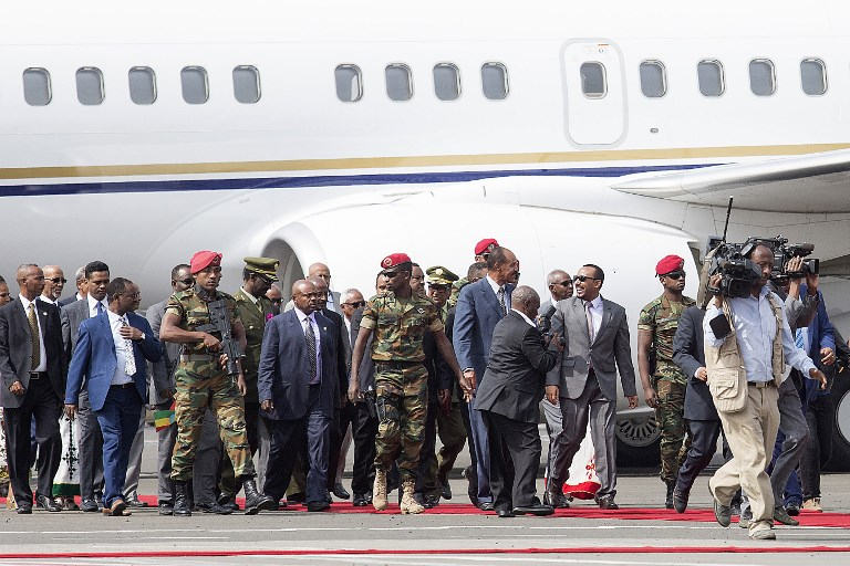 HISTORIC VISIT. Eritrea President Isaias Afwerki (5th from right) is received by Ethiopia Prime Minister of Abiy Ahmed as he arrives at the Bole International airport in Addis Ababa on July 14, 2018. File photo by Maheder Haileselassie Tadese/AFP