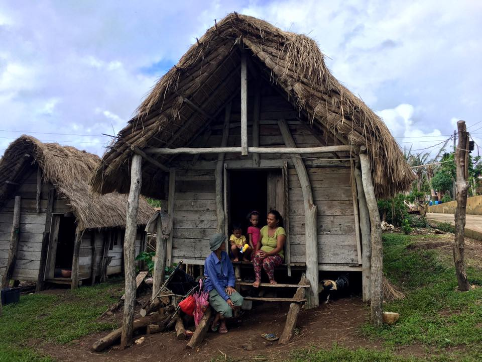 CHANGE IS COMING. Nanang Tinang, a community elder in Itbayat, Batanes, talks to Clara Magasing and her two children in Barangay Yawran, Itbayat, one of the worst-affected villages by Typhoon Ferdie. Photo by Airah Cadiogan/Oxfam