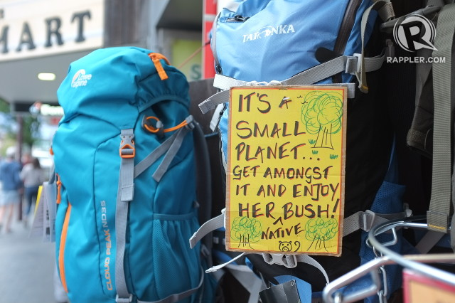 GEAR MANIA. Second-hand climbing packs (and the playful and laidback Kiwi attitude) on display in a Queenstown store