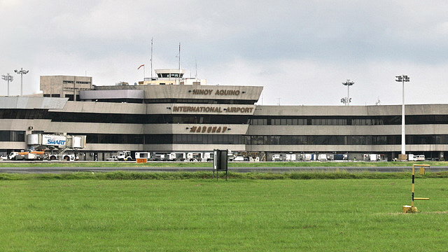 NO TO TERMINAL FEES. Long queues at the Ninoy Aquino International Airport remain a problem for OFWs. Photo from Wikipedia