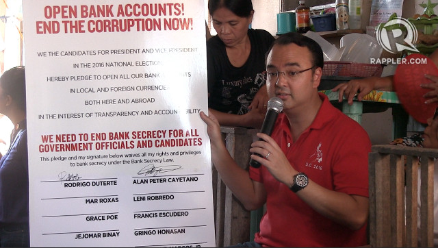 MANIFESTO. Vice-presidential bet Alan Peter Cayetano shows his and Duterte's signatures on a manifesto to open their bank accounts. Screengrab from Rappler video