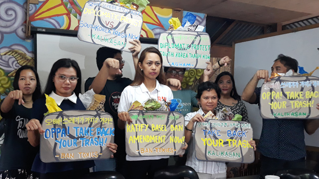 TAKE BACK YOUR TRASH. Environmental advocates protest importation of garbage.