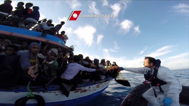 SEA RESCUE. In this video grab released by the Italian Coast Guards (Guardia Costiera) on April 13, 2015 a boat of the Italian Guardia Costiera takes part in a rescue operation of migrants off the coast of Sicily on April 12, 2015. Guardia Costiera/AFP