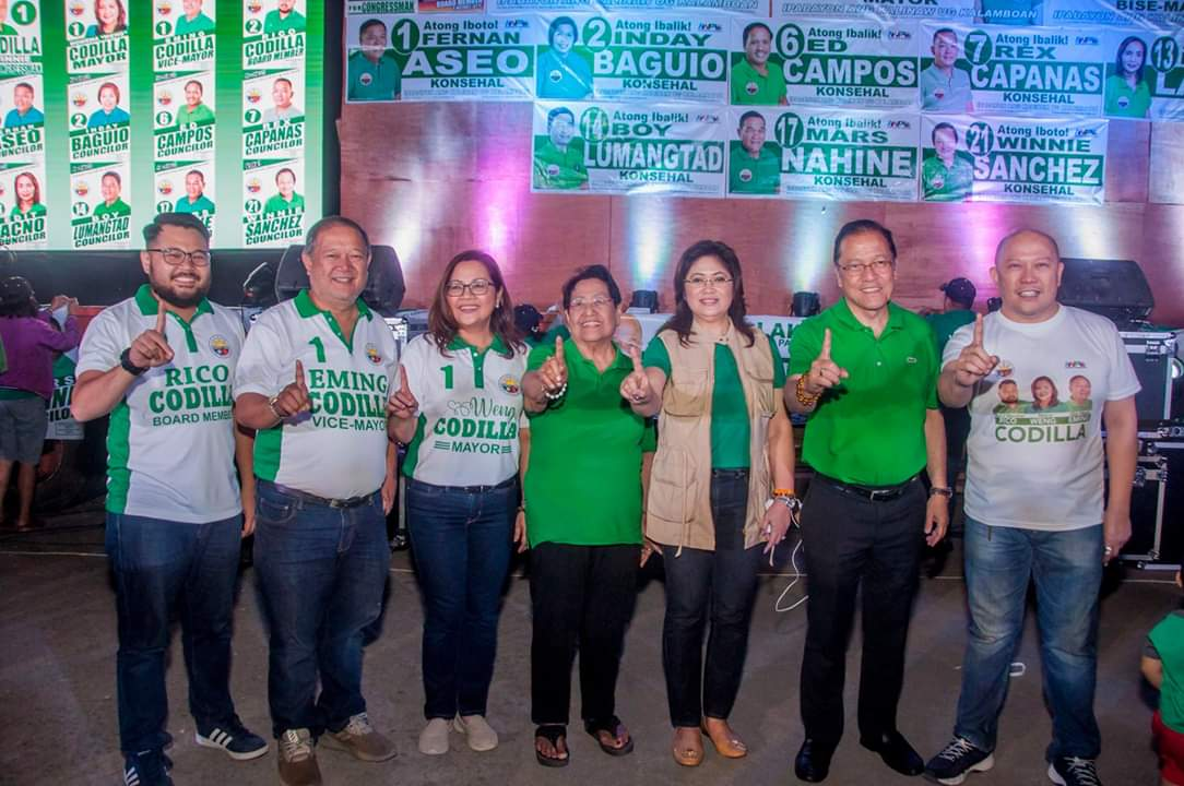 LAST BAILIWICK. (From left to right) Leyte Board Member bet Rico Codilla, Kananga, Leyte Vice Mayor reelectionist Elmer u0022Emingu0022 Codilla, Kananga, Leyte Mayor reelectionist Rowena u0022Wengu0022 Codilla, unidentified woman, Ormoc City vice mayoral bet Jingjing Codilla, Ormoc City mayoral bet Eric Codilla, and unidentified man join the campaign sortie at their remaining bailiwick, Kananga on March 31, 2019. Photo taken from Rowena Codilla's Facebook page