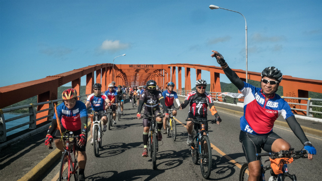 BREAK FREE. Cyclists arrive at the iconic San Juanico Bridge to protest against the use of fossil fuel. Photo by Greenpeace