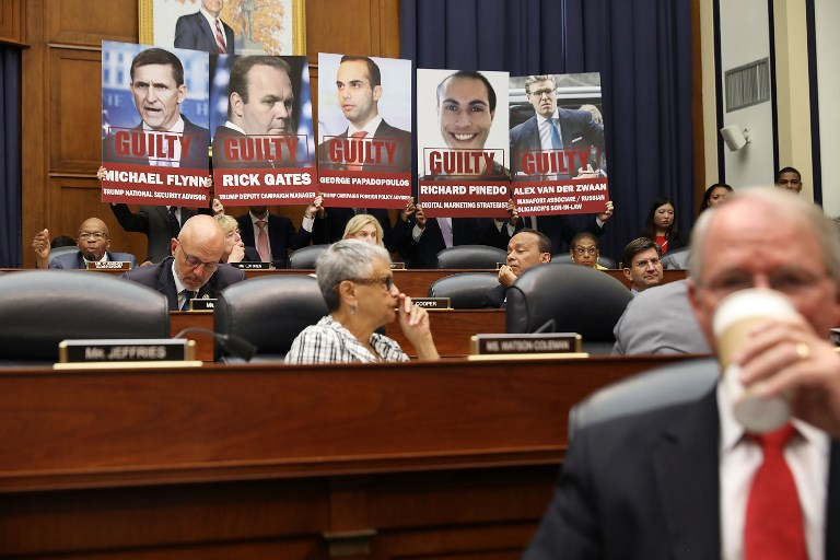 GUILTY. Images of people who have pleaded guilty in Special Counsel Robert Mueller's investigation are displayed in the US House of Representatives in the Capitol Hill July 12, 2018 in Washington, DC. Photo by Chip Somodevilla/Getty Images/AFP