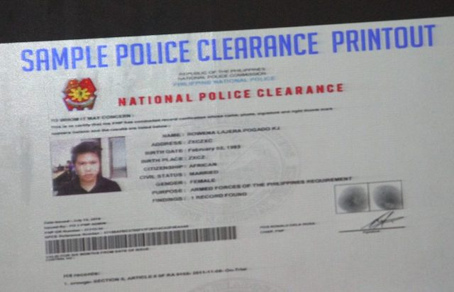 NEW CLEARANCE? A sample police clearance is flashed during a briefing in Camp Crame. PNP photo