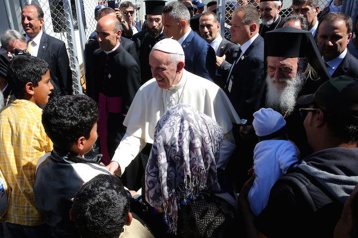 WELCOME. Pope Francis visits the Greek island of Lesbos, accompanied by Ecumenical Patriarch Bartholomew in a trip aimed at supporting refugees and drawing attention to the frontline of Europe's migration crisis. Photo by Orestis Panagiotou/EPA