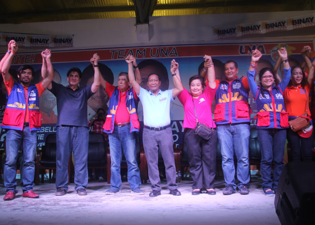 BINAY AND COMPANY. VP Jejomar Binay raises the hands of local candidates in Partido area led by the powerful Arnulfo Fuentebella. Photo by Rhaydz B. Barcia