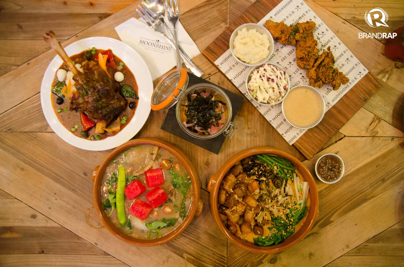 FILIPINO WITH A TWIST. Moonshine offers old favorites with a twist in its menu like Smoked Kinilaw, Lamb Shank Caldereta, Beef Short Rib Sinigang, Crispy Kare-Kare and Dolinou2019s own fried chicken, JFC. Try their secret Danggit and Salted Egg Pizza, too! Photo by Pauee Cadaing/Rappler