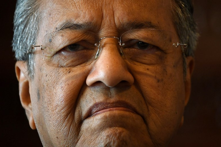 UNDER SIEGE. In this file picture taken on December 6, 2016 Malaysia's former prime minister Mahathir Mohamad gestures during an interview with AFP at his office in Putrajaya. Photo by Manan Vatsyayana/AFP