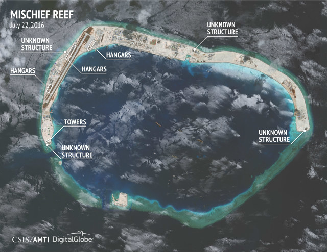 MISCHIEF REEF. u0080The construction of hangars on Mischief Reef is said to be part of China's militarization of the West Philippine Sea. Photo courtesy of CSIS/AMTI and DigitalGlobe
