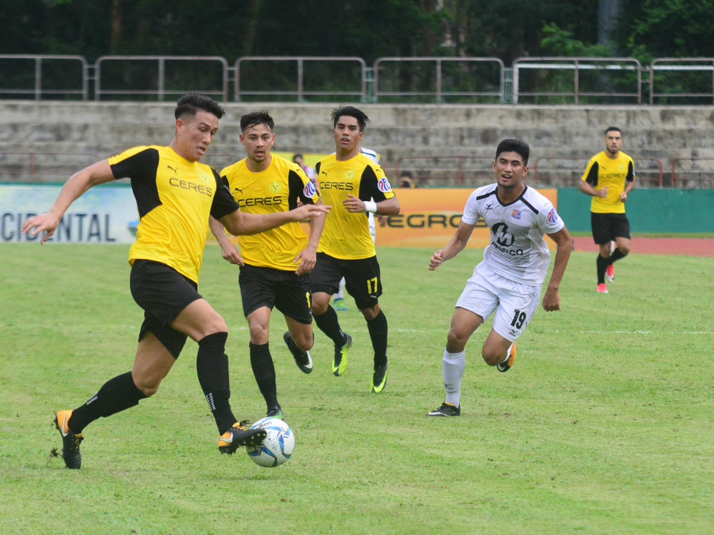 PLAY FOR GLORY. Left to right in yellow: Luke Woodland, Kevin Ingreso, Junior Muu00f1oz and Iain Ramsay look to step up against Istiklol. Photo by Bob Guerrero/Rappler