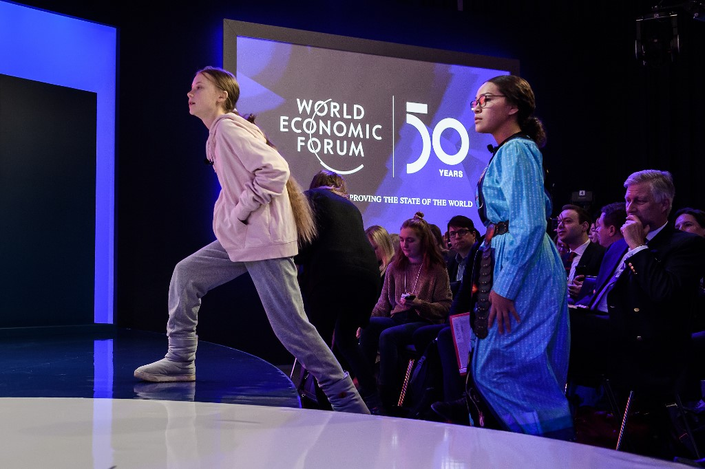 YOUTH VOICE. Swedish climate activist Greta Thunberg (lef), followed by Canadian climate and environmental activist Autumn Peltier, arrives to the Congres center during the World Economic Forum (WEF) annual meeting in Davos, on January 21, 2020. Photo by Fabrice Cofffrini/AFP