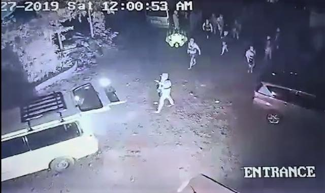 ARMED MEN. A video grab of the CCTV footage outside the Jalandoni residence in Canlaon City, Negros Oriental shows heavily armed men who break into the property.