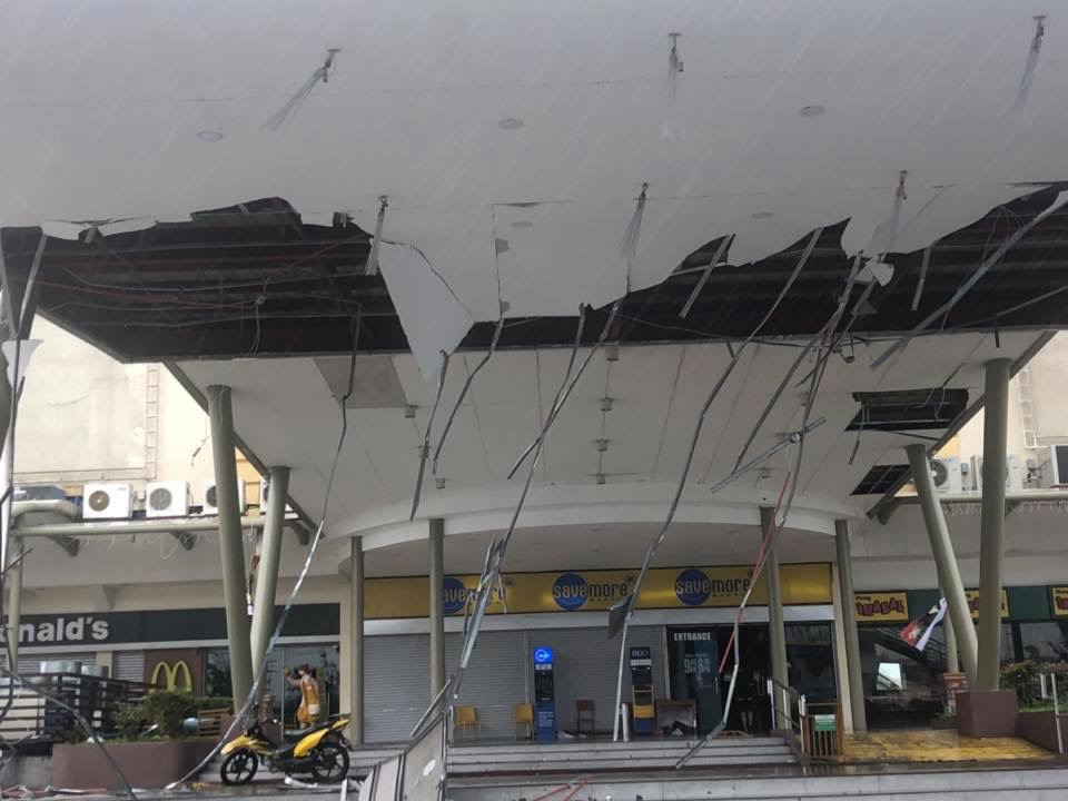 TORN. The typhoon rips off the ceiling of a mall entrance in Ilagan City. Photo by Fr Grevie Uanan