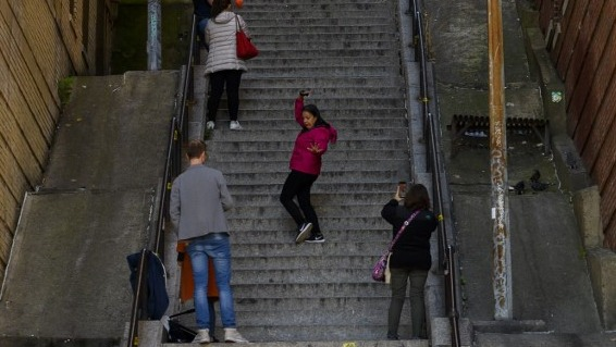 JOKER STEPS. Visitors pose and take selfies on the staircase in the Bronx, made famous by the movie 'u0080u0098Joker'u0080u0099 in New York. Photo by Don Emmert/AFP
