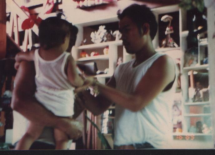 A photo of Papa and my older sister, Bea, taken from our home in Moncada, Tarlac.