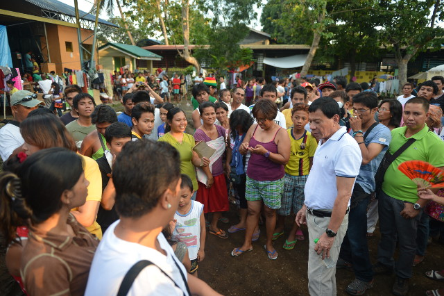GETTING THE PULSE. Rody Duterte is fond of visiting the barangays of Davao City. Photo from Davao City government
