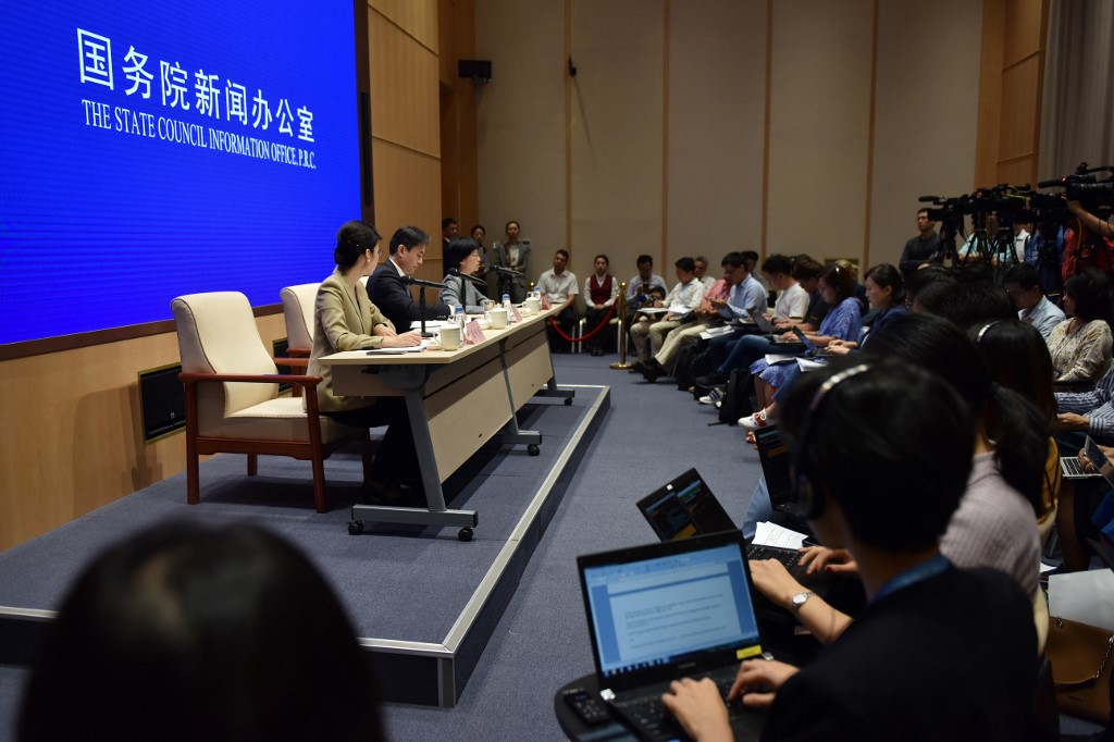 WARNING. Yang Guang (2nd left) and Xu Luying (3rd left), spokespersons for mainland China's Hong Kong and Macau Affairs Office (HKMAO) of the State Council, take part in a press conference concerning the ongoing protests in Hong Kong, in Beijing on August 6, 2019. Photo by Greg Baker/AFP