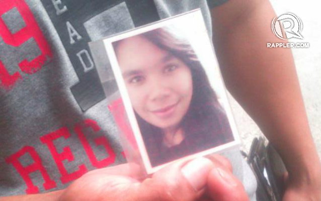 SISTER. Ammied Rada shows a photo of his 21-year-old sister Gerly, who died in the May 13 factory fire. Photo by Buena Bernal/Rappler