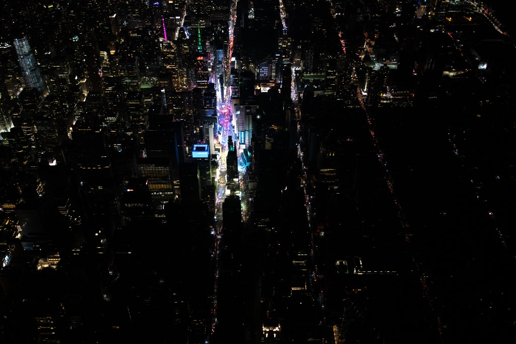 BLACKOUT. A large section of Manhattan's Upper West Side and Midtown neighborhoods are seen in darkness from above during a major power outage on July 13, 2019 in New York City. Photo by Scott Heins/Getty Images/AFP