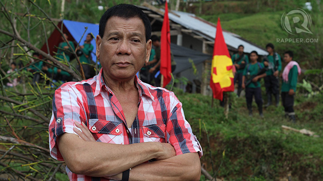 LEFT-LEANING? Davao City vice-mayor Rodrigo Duterte poses in front of an NPA camp in Compostela Valley. File photo by Karlos Manlupig.