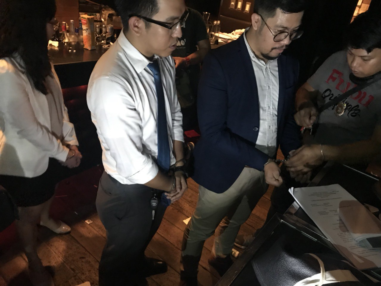 OBSTRUCTION? Cops detain lawyers at the Makati Police Station on August 16, 2018, for taking notes and photos during a police inventory of a raided bar. Photo courtesy of the Southern Police District