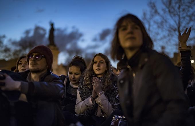 NUIT DEBOUT. Participants take part in a general assembly sit-in session on Place de la Republique, to protest against the labor law reform bill in Paris, France. Photo by Ian Langsdon/EPA