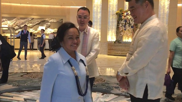 ALL SMILES. Once rivals, former foreign affairs secretary Alan Peter Cayetano greets House Speaker Gloria Macapagal Arroyo. Photo by Alecs Ongcal/Rappler