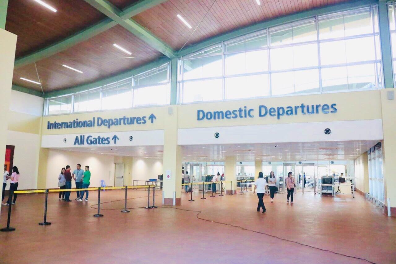 DEPARTURE. Hallways for international and domestic departures.