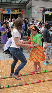 An open house visitor tries tinikling. Photo from Philippine Embassy Washington DC Facebook page