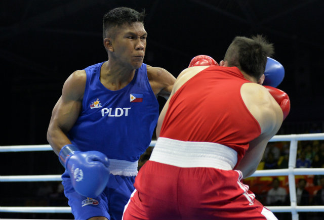 Eumir Marcial lands a straight left on Jia Wey Tay of Singapore. Photo by Singapore SEA Games Organising Committee/Action Images via Reuters