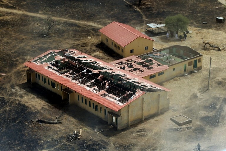 BURNED OUT. This picture taken on March 5, 2015 shows an arial view of the burnt-out classrooms of a school in Chibok,in Northeastern Nigeria, from where Boko Haram Islamist fighters seized 276 teenagers on the evening of April 14, 2014. Photo by Sunday Aghaeze / AFP
