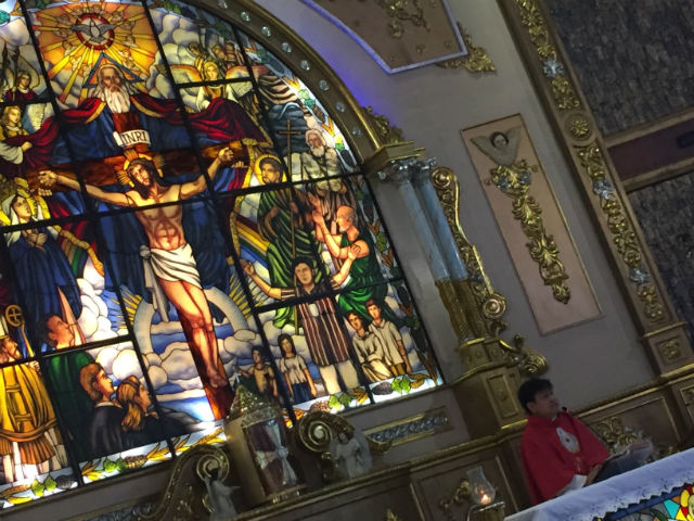 LOOK WHO'S THERE. The image of Richie Fernando, his arms raised, is included in the stained glass retablo (lower right portion) at Mary the Queen Parish in Novaliches, Quezon City, a few steps away from the Fernandos' residence. Photo by Paterno Esmaquel II