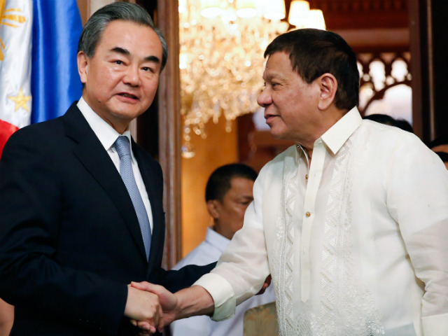 CLOSER TIES. Philippine President Rodrigo Duterte shakes hands with Chinese Foreign Minister Wang Yi, who was paying a courtesy call in Malacau00f1ang on July 25, 2017. Malacau00f1ang file photo