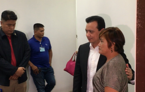 SUPPORTER. Trillanes takes a photo with one of his supporters who visited his office. Photo by Camille Elemia/Rappler