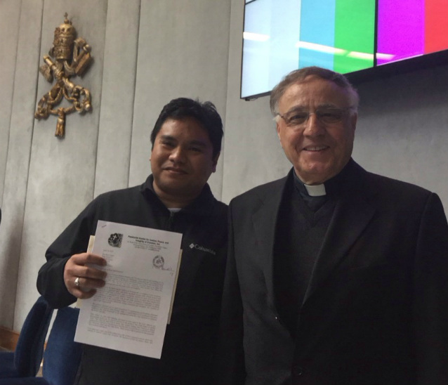 PASSIONISTS. Father Rey Ondap holds his letter to Pope Francis as he stands beside Vatican press office vice director and fellow Passionist, Father Ciro Benedettini. Photo from Ondap