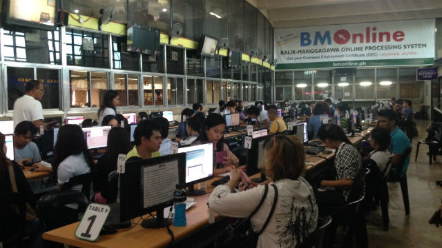 TICKET TO WORK. Overseas Filipino workers applying for their overseas employment certificates through the POEA's Balik Manggagawa Online Processing System. Photo by Mara Cepeda/Rappler