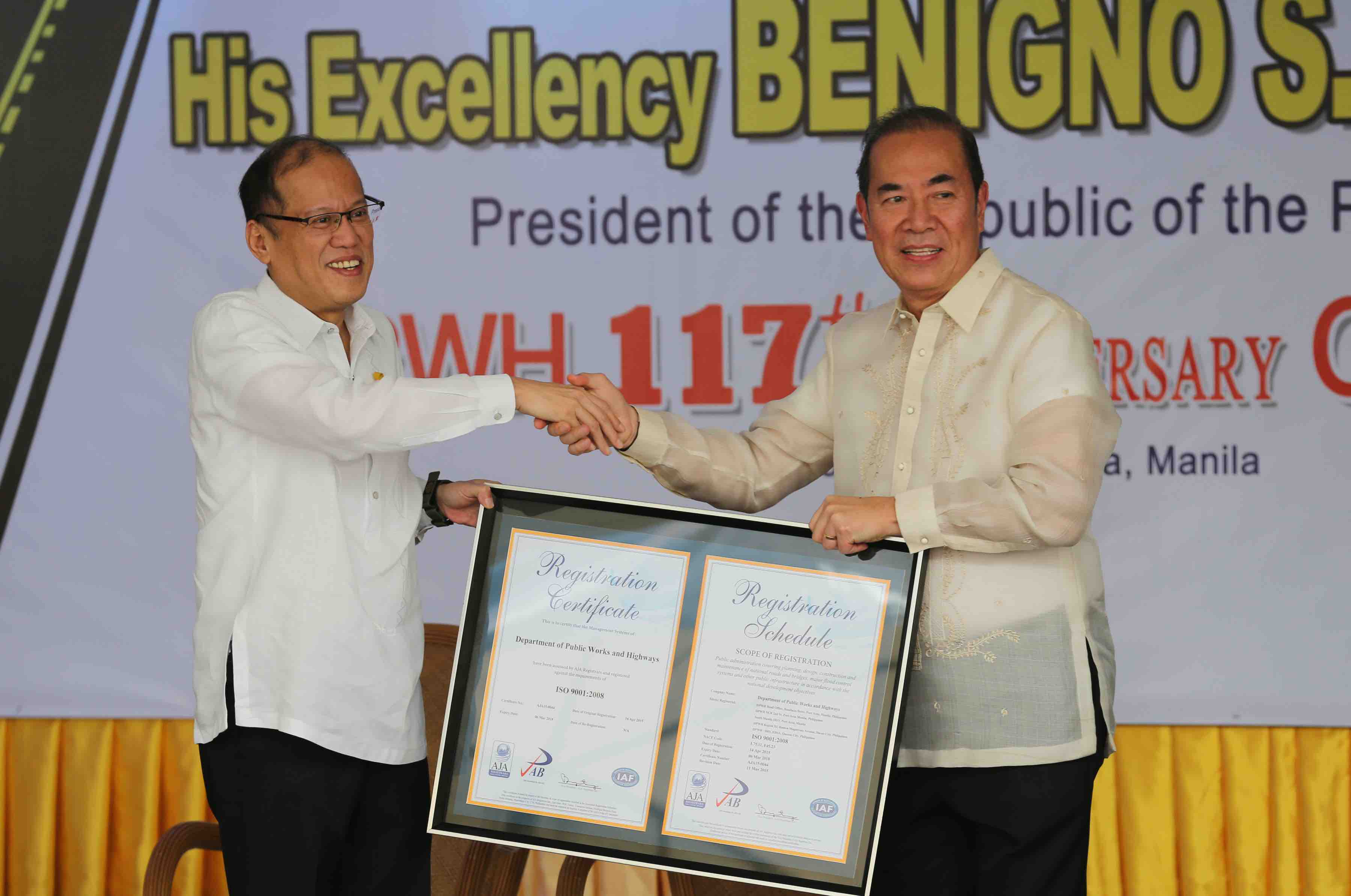 President Benigno S. Aquino III receives a copy of a framed ISO 9001:2008 Registration Certificate of DPWHu2019s Quality Management System (QMS) presented by Public Works and Highways Secretary Rogelio Singson during the 117th anniversary of the Department of Public Works and Highways (DPWH) at the DPWH Quadrangle of the Central Office in Bonifacio Drive Port Area, Manila City on Monday (June 22, 2015). This yearu2019s theme: u201cDPWH: Sa Daang Matuwid, Para Sa Diyos at Bayanu201d. (Photo by Lauro Montellano, Jr. / Malacau00f1ang Photo Bureau)