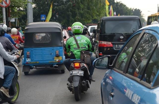 GOJEK. Gojek berekspansi ke Medan, Palemabang, Semarang, Yogyakarta, dan Balikpapan. Foto oleh Adek Berry/AFP