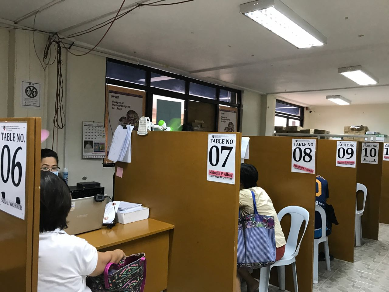 FRONTLINER. DSWD staff accepting requests for assistance at the agency's crisis intervention unit. Photo by Patty Pasion/Rappler