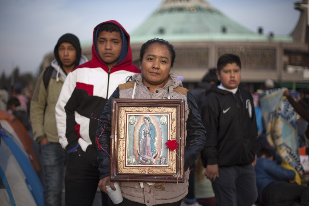 FERVENT. Pilgrims pose with an image of the Virgin of Guadalupe during the annual celebrations at the Basilica of Guadalupe in Mexico City, on December 12, 2019. Photo by Claudio Cruz/AFP